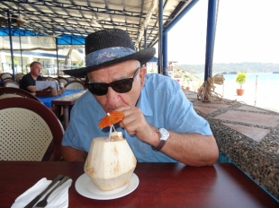 enjoying a fresh coconut at Blue Rock