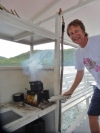 Stoking the Wood Fire on a Wooden Boat