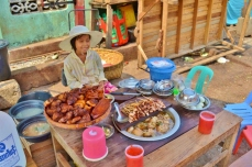 Young Street Vendor Selling Pork