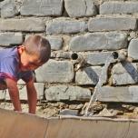 Xinaliq Boy at Water Supply