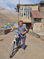 Xinaliq Boy on Bike