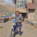 Xinaliq Boy on Bike