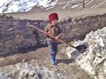Xinaliq Boy Shovelling Snow