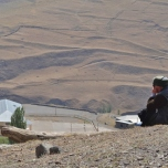 Xinaliq Man Looks Out Over New School