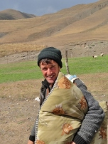 Xinaliq Shepherd Heads Off to Work